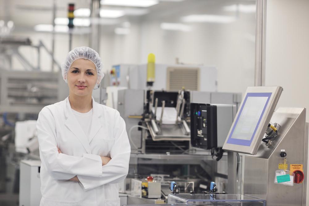 woman worker in pharmacy company warehouse
